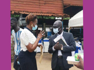 Yea Penda talks to the Permanent Secretary, Ministry of Health-The Gambia, during an inauguration ceremony at The Riders For health head office.